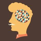 Hipsterhuvud med tankar om färgrika trianglar Arkivbild