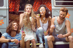 Hipsters blowing bubbles in camper van Royalty Free Stock Image