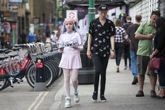 Hipsters on Brick Lane in the East End of London, UK . distributor of flyers. LONDON, UK - August 27, 2016: Hipsters on Brick Lane in the East End of London, UK stock image