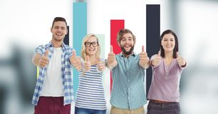 Hipsters gesturing thumbs up while standing against graph. Digital composite of Hipsters gesturing thumbs up while standing against graph Royalty Free Stock Photo