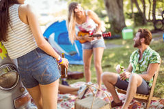 Hipsters having fun in their campsite Stock Images