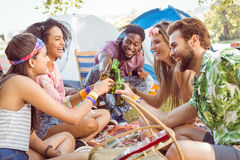 Hipsters having fun in their campsite Royalty Free Stock Images