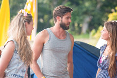 Hipsters having fun in their campsite Royalty Free Stock Photography