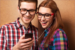 Hipsters listening music together. Stock Images