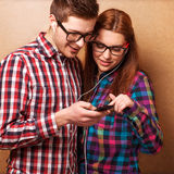 Hipsters listening music together. Royalty Free Stock Images