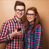 Hipsters listening music together. Young couple listening music together. Hipster style Stock Photos