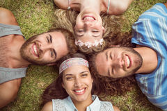 Hipsters lying on grass smiling Royalty Free Stock Photo