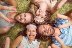 Hipsters lying on grass smiling Royalty Free Stock Images