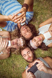 Hipsters lying on grass smiling Stock Image