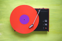 Hipsters retro turntable with red vinyl record. Free copy space. Note: The exact rendering of the black grainy surface of the turntable is no Camera Noise Stock Photo