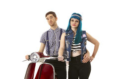 Hipsters with scooter. A modern retro couple with classic motor scooter. isolated Stock Photography