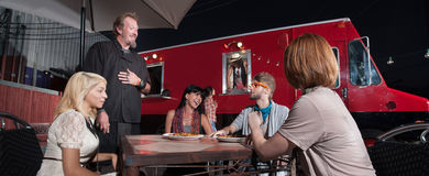 Hipsters Talking with Chef Outside Stock Photography