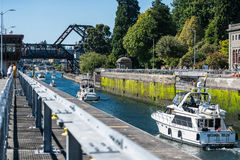 The Hiram M Chittenden Locks. Boats pass through the Hiram M Chittenden Locks in Ballard, Washington near Seattle stock images