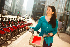Hire bike. Happy young woman with a hire bike in london royalty free stock photo