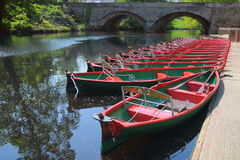 Hire boats & bridge, river Nidd, Knaresborough, UK. Riverside view of rowing hire boats and old bridge in Knaresborough, taken from the bank of river Nidd in Royalty Free Stock Photo