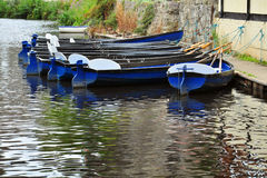 Hire boats on river surface with reflections Royalty Free Stock Photos