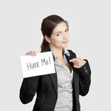 Hire me. Business woman holding a card board with the text message Hire me Royalty Free Stock Image