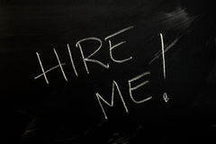 Hire Me. Handwritten text Hire Me on the blackboard Stock Photo