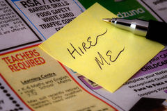 'Hire Me' sticker on newspaper Royalty Free Stock Photo
