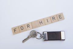 For hire. The writing for hire with the key Royalty Free Stock Photos