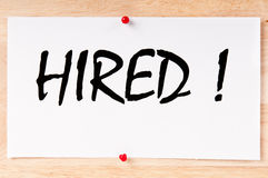 Hired. Written on paper and posted on a board Royalty Free Stock Images