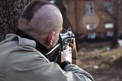 A hired killer aims to shoot his victim Stock Photography