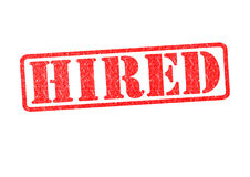 HIRED Rubber Stamp. Over a white background Royalty Free Stock Photos