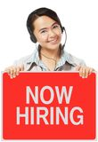 We Are Hiring. A woman wearing a headset holding a sign on hiring Royalty Free Stock Photo