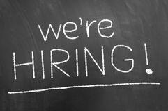 We are hiring announcement chalk text on blackboard or chalkboar stock photography