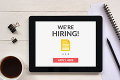 We are hiring apply now concept on tablet screen with office obj. Ects on white wooden table. All screen content is designed by me royalty free stock photos