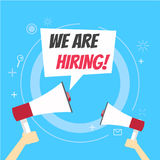 We are hiring banner. Join our team. Blue background and hands holding a megaphone Royalty Free Stock Images