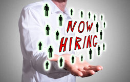Hiring concept above a human hand Royalty Free Stock Images