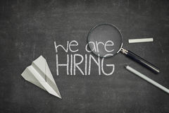 We are hiring concept on black blackboard with Stock Photos