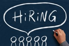 Hiring Concept For Business. Hiring concept on the chalkboard with writing hand royalty free stock images