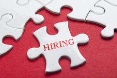 HIRING concept.  Missing Piece Jigsaw Puzzle with word Royalty Free Stock Photo