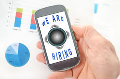 Hiring concept on a smartphone. Held by a hand royalty free stock photo