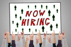 Hiring concept on a whiteboard. Pointed by several fingers royalty free stock image
