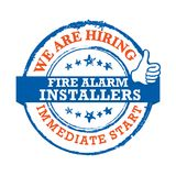 We are hiring Fire Alarm Installers - label for print. Fire Alarm Installers - We are hiring, immediate start - Job advertising / Job offer - Grunge label. Print Royalty Free Stock Images