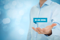 We are hiring. Headhunter recruiter hold virtual label with text we are hiring - human resources HR concept royalty free stock image