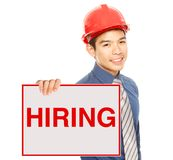 We Are Hiring. A man holding a job hiring signboard or poster Stock Images