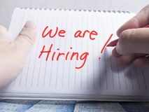 We Are Hiring, Motivational Business Recruitment Words Quotes Concept. Words letter, written on paper, work desk top view typography stock photos