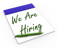 We Are Hiring Notebook Shows Employment. We Are Hiring Notebook Showing Employment Recruitment Or Personnel Wanted Royalty Free Stock Photography