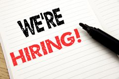 We Are Hiring Now. Business concept for Recruitment Human Resources written on notebook with copy space on book background with m. We Are Hiring Now. Business stock photos