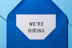 We are hiring phrase written in the paper at blue envelope. human resources concept.  Royalty Free Stock Image