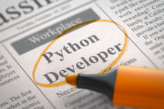 We are Hiring Python Developer. 3D. A Newspaper Column in the Classifieds with the Jobs Section Vacancy of Python Developer, Circled with a Orange Marker Royalty Free Stock Photography