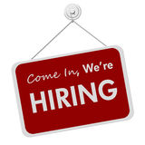 We are Hiring Sign. A red and white sign advertising that a business is hiring Stock Photo