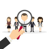 Hiring staff concept. Hand with magnifying glass finding and recruiting new worker Stock Photography
