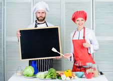 Hiring staff. Woman and man chef hold blackboard copy space. Job position. Cooking delicious meal recipe. Cooking menu. Hiring staff. Woman and men chef hold stock image