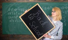 Hiring teachers for new school year. Woman teacher holds blackboard inscription back to school. Back to school teachers