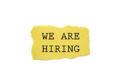 We are hiring!. Text written on torn brown paper royalty free stock photography